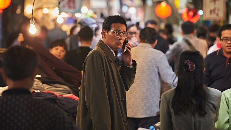 man with phone in a crowd